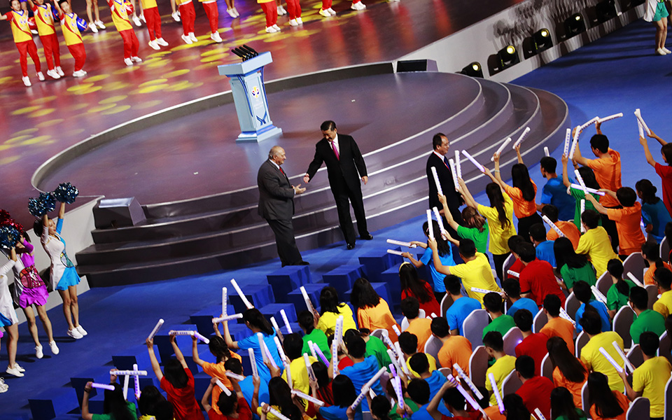FIBA President Horacio Muratore, center left, and Chinese President Xi Jinping shake hands at the FIBA Basketball World Cup 2019 opening ceremony at the Beijing National Aquatics Center or Water Cube in Beijing, China, Friday, Aug. 30 2019. (How Hwee Young/Pool Photo via AP)