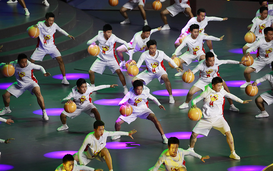 epa07804555 Performers perform during the FIBA Basketball World Cup 2019 opening ceremony at the Beijing National Aquatics Center or Water Cube in Beijing, China, 30 August 2019. EPA/HOW HWEE YOUNG